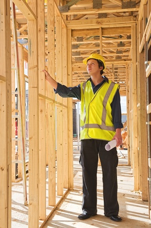 safety jacket: A young businessman at the construction site Stock Photo