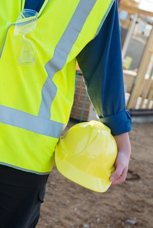 A young worker at the construction site with safety equipment photo