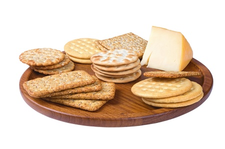 some: some crackers on the wooden plate isolated on white background