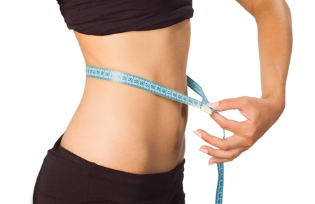 weight loss success: Girl showing how much weight she lost isolated on white Stock Photo