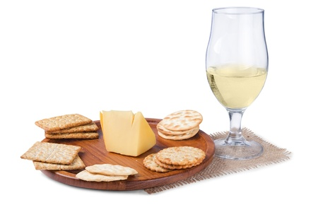 some crackers on the wooden plate and wine isolated on white background photo