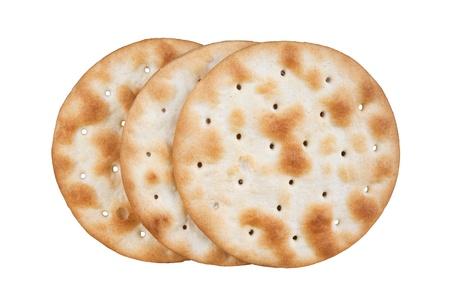 galletas integrales: algunas galletas de trigo sobre fondo blanco