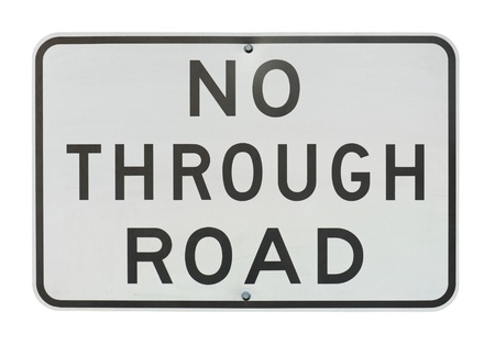 old no through road traffic sign isolated on a white background. photo
