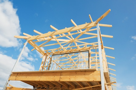 New residential construction home wooden framing against a blue sky Stock Photo - 11653135