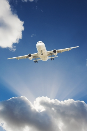 airplane take off: Large passenger airplane flying in the blue sky