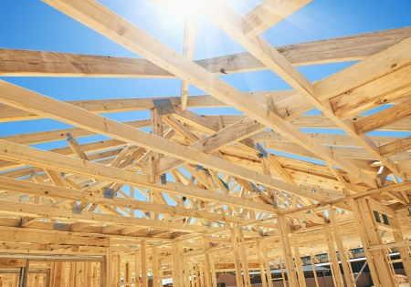 New residential construction home framing with roof view photo