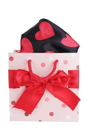 Funny  gift bag with heart tissue isolated on white background  photo