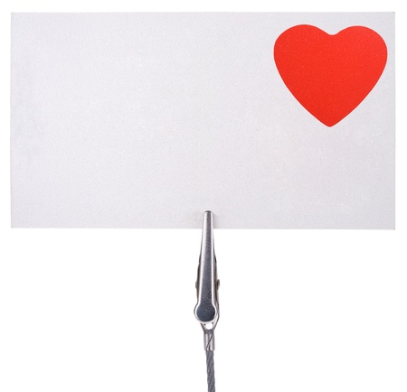 attach: blank card with a red heart attach by a clip  isolated on white background