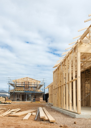 timber frame: New residential construction home wooden framing against a blue sky Stock Photo