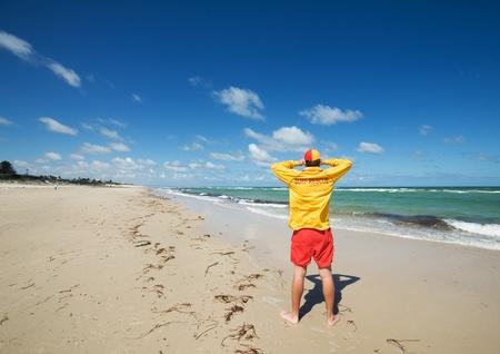 savers: young man  life saver  watching the situation on the sea