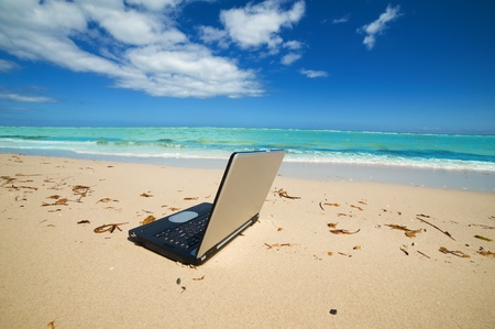laptop on the beach as a   freelance idea photo
