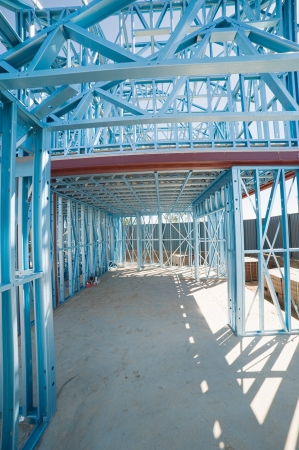 studs: New home under construction using steel frames Stock Photo