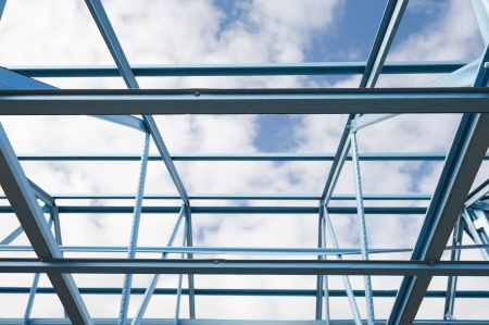 steelwork: New residential construction home metal framing against a blue sky.Fragment.