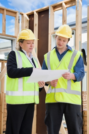 civil engineer and worker discussing issues at the construction site Stock Photo - 13829203