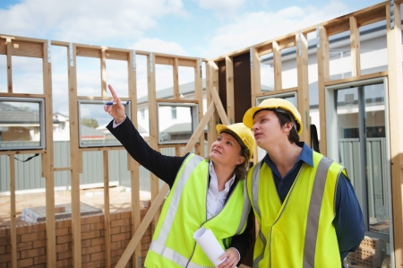 civil engineer and worker discussing issues at the construction site Stock Photo - 13878697