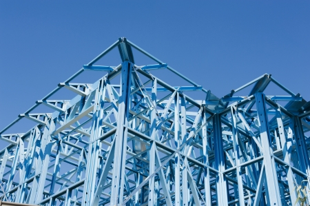 New residential construction home metal framing against a blue sky photo