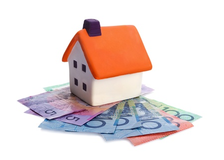 Real estate concept - house and money on white background photo
