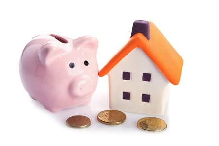 australian money: conceptual image with piggy  bank, coin and house