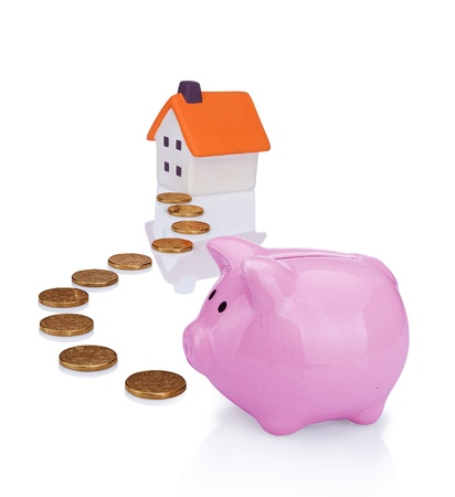 conceptual image with piggy  bank, coin and house photo