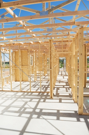 studs: New residential construction home wooden framing against a blue sky Stock Photo