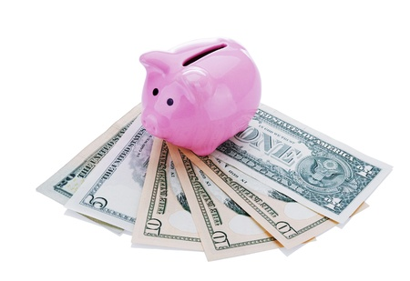 Pink piggy bank with banknotes isolated on white background photo