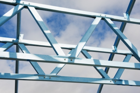 New residential construction home metal framing against a  sky photo