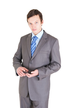 moneymaker: Young businessman with mobile phone isolated on white background Stock Photo