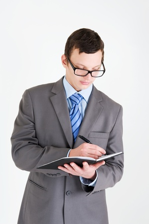 Portrait of handsome young businessman with notebook photo