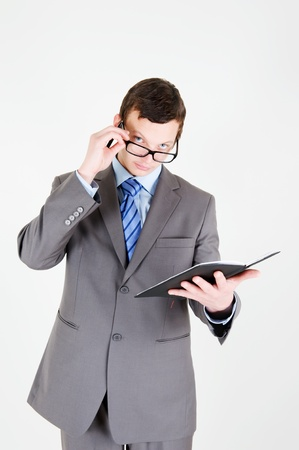 moneymaker: Portrait of handsome young businessman with notebook Stock Photo