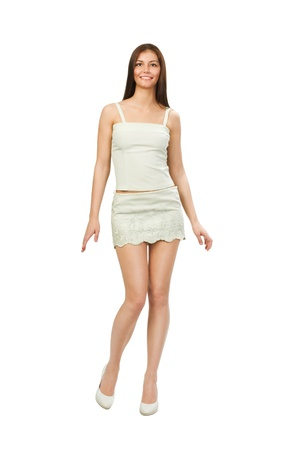 short skirt: dancing young woman in a nice summer dress isolated on white background.