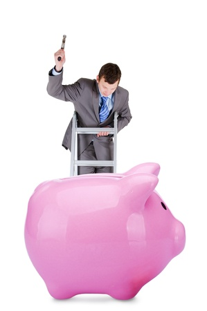 young businessman going to  break the piggy bank isolated on white background photo