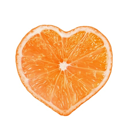 Slice of fresh orange heart shaped  isolated on white background  photo