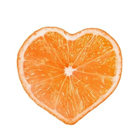 Slice of fresh orange heart shaped  isolated on white background  photo