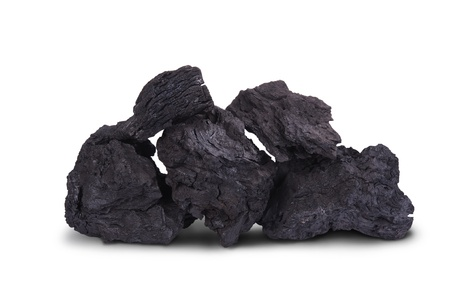 heap of black charcoal  for BBQ isolated on white background photo