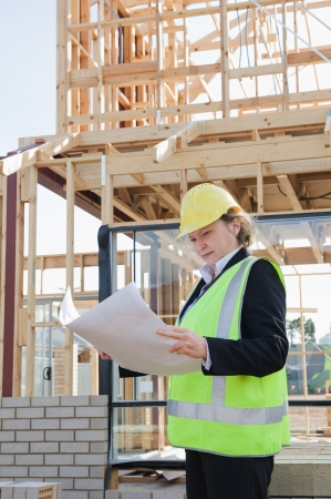 workplace safety: civil female engineer at the construction site