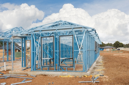 roof framing: New home under construction using steel frames against cloudy sky Editorial
