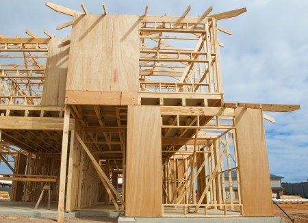 New residential construction home framing against a blue sky. Stock Photo - 16113276