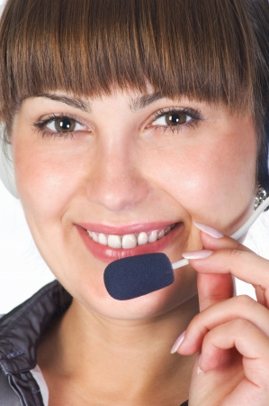 Friendly helpdesk girl Portrait of a happy young woman wearing headphones  photo