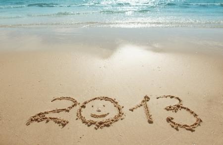浜辺の砂 - 新年の概念桁 2013 写真素材