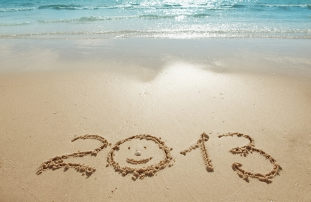 digits 2013 on the sand seashore - concept of new year Stock Photo