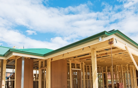 wooden joists: New residential construction home framing with roof view