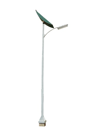 street lamppost with solar panel isolated on white background photo