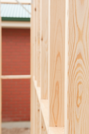 studs: New residential construction home framing fragment.Shallow focus. Stock Photo