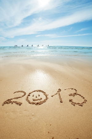 digits 2013 on the sand seashore - concept of new year photo