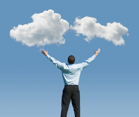 beautiful clouds and happy young man with his hands up.Concept image on cloud computing and rest photo