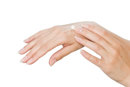 Two woman hands with moisturizer body cream isolated on white photo
