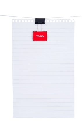 data sheet: Blank note paper with red binder clip isolated on white background