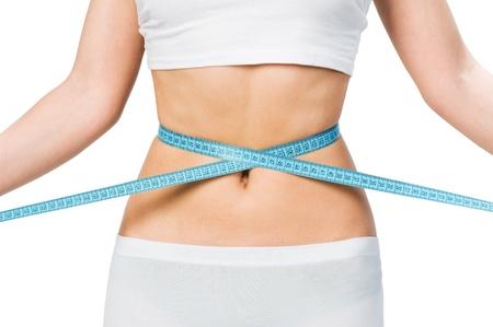 gordo y flaco: Chica mostrando cu�nto peso perdi� aislado en blanco Foto de archivo