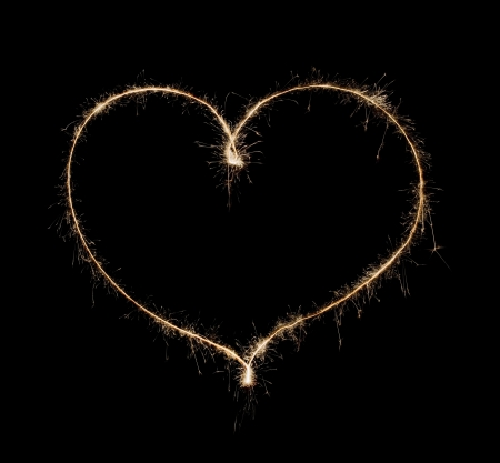heart from sparkler isolated on black background photo