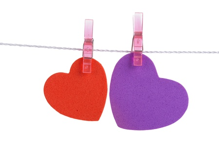 two foam shapes hearts pinned together isolated on white background photo